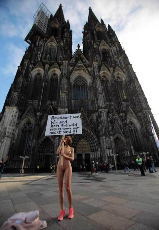 NudeWomantProtestOutsideCologneCathedral