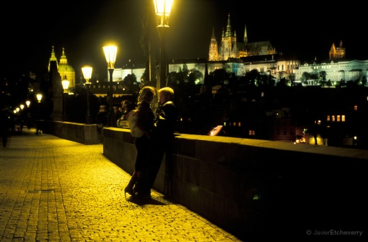 Couple at Night on Charles Bridge, Prague, Czech Republic